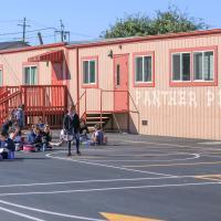 St. Paul School photo of children in front of mural